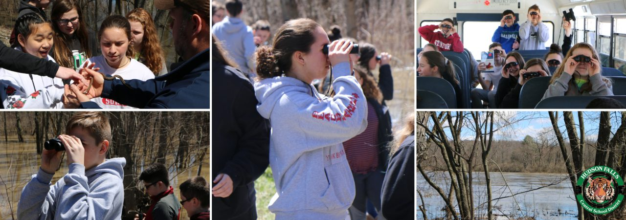 photo shows several students using binoculars to view wildlife