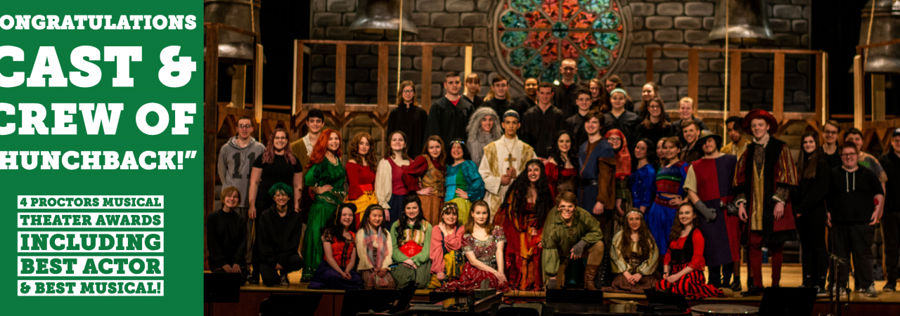 photo shows group of student actors smiling at camera