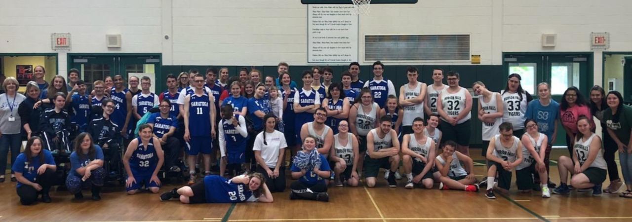 photo shows group of unified basketball team smiling