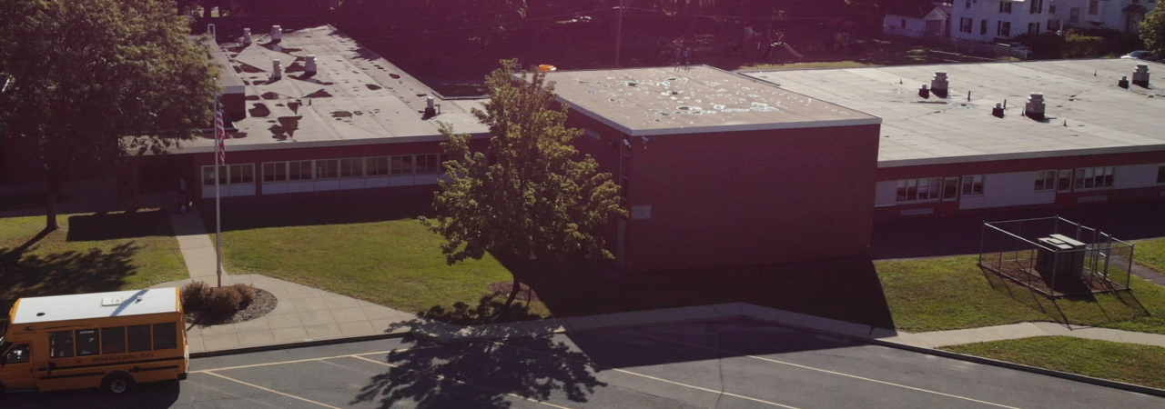 photo shows aerial view of kindergarten center during summer
