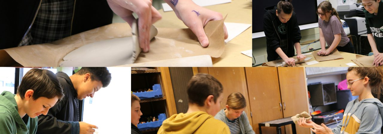 photo shows students working with clay