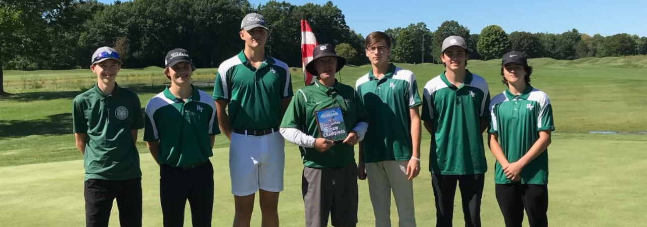 photo shows group of boys at golf course smiling